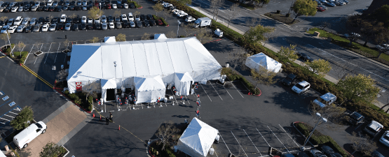 outdoor corporate event with large tent