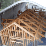construction tent over house frame
