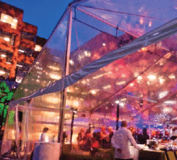 large outdoor tent with clear walls