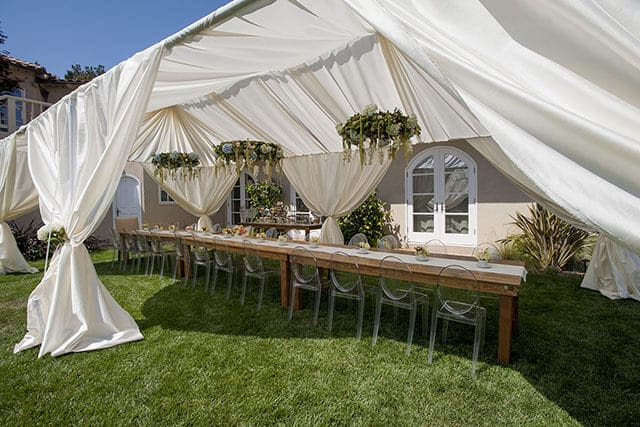outdoor wedding reception under elegant tent