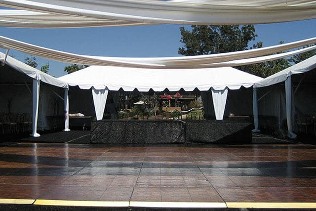 outdoor stage with dance floor and tenting