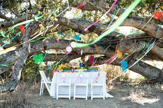 outdoor birthday party setting under trees