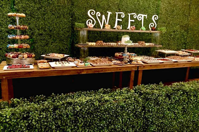 long table buffet of sweets and desserts